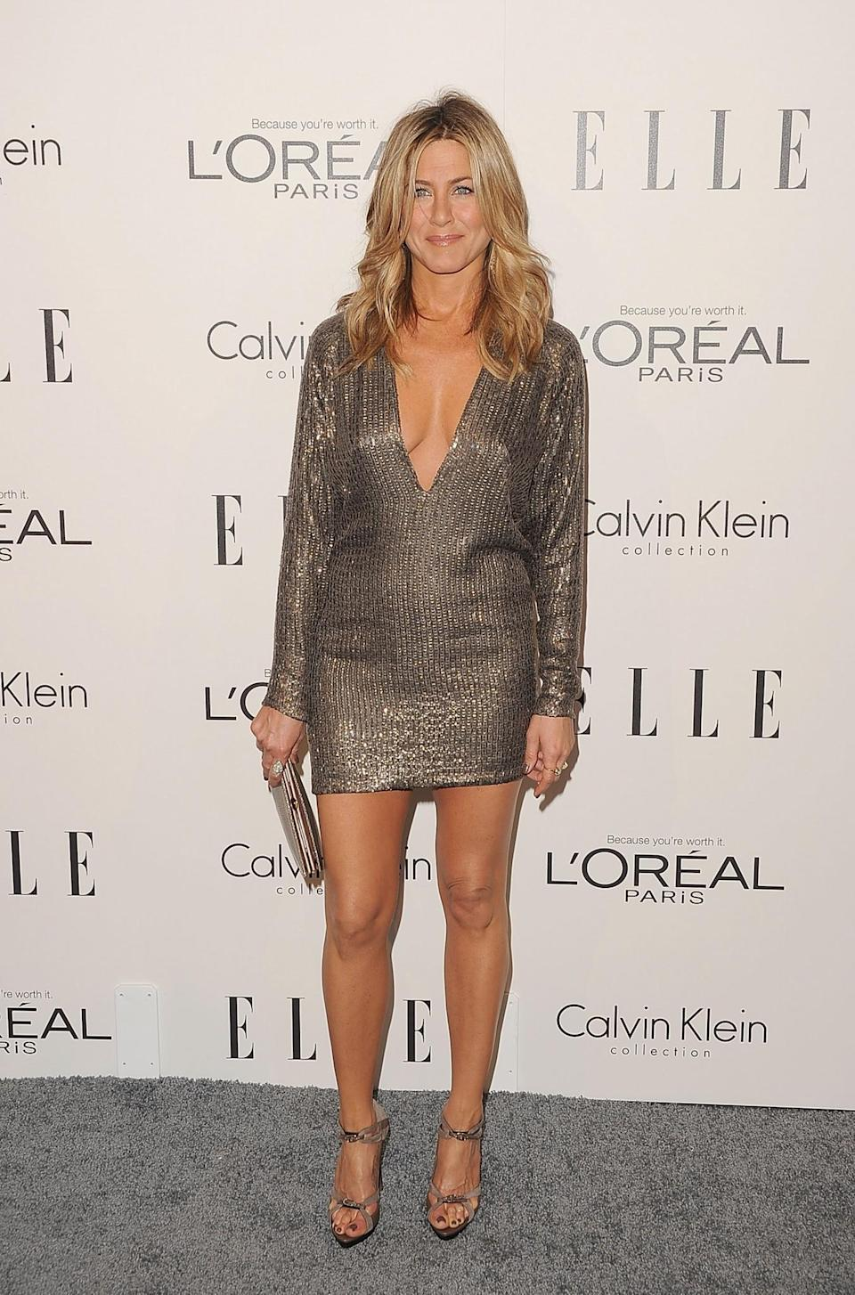<p>Jennifer gets the thumbs up from us in this plunging metallic mini dress. <i>[Photo: Getty]</i> </p>