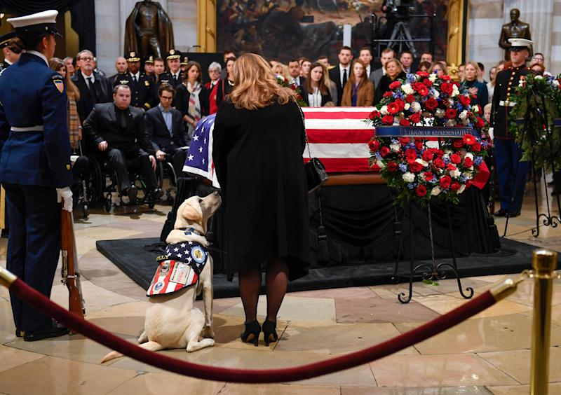 President George H.W. Bush's service dog, Sully, with Valerie Cramer of America's VetDogs at the U.S. Capitol to honor late president on Dec. 4, 2018. Sully, a service dog trained by America's VetDogs, will join Walter Reed National Military Medical Center's Facility Dog Program after the holidays.