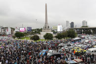 Pro-democracy protesters gather at Victory Monument in Bangkok, Thailand, Sunday, Oct. 18, 2020. Thai police on Sunday declined to say whether they were taking a softer approach toward student anti-government demonstrations, after several mass rallies attracting thousands of protesters ended peacefully in Bangkok on Saturday. (AP Photo/Sakchai Lalit)