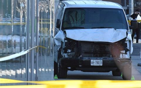 A damaged van that struck multiple people in Toronto - Credit: Reuters