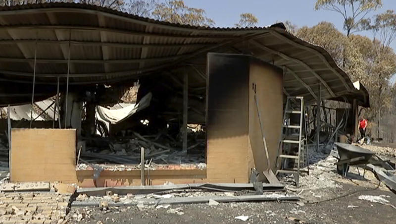 """This image made from video shows burnt property in Yeppoon, Queensland state, Australia, Wednesday, Nov. 13, 2019. Wildfires destroyed nine homes on Monday in Queensland state, where air quality plummeted in Brisbane, the state capital, and surrounding cities to the lowest possible rating of """"very poor.""""(Australian Broadcasting Corporation via AP)"""