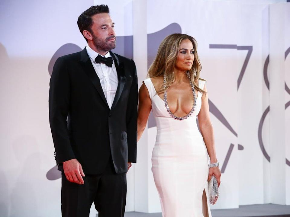 Ben Affleck and Jennifer Lopez pose on the red carpet at the premiere of 'The Last Duel' at the Venice Film Festival on 10 September 2021 (Joel C Ryan/Invision/AP)