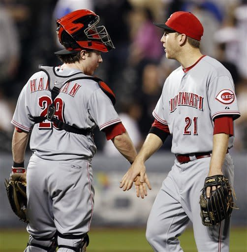 Cincinnati Reds catcher Ryan Hanigan (29) congratulates third baseman Todd Frazier (21), who hit two home runs, after their 6-3 win over the New York Mets in a baseball game at Citi Field in New York, Wednesday, May 16, 2012. (AP Photo/Kathy Willens)