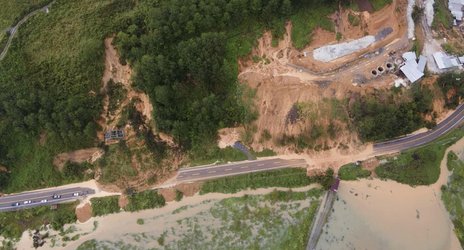 A road is blocked by a landslide in Purulha, northern Guatemala Friday, November 6 as the remnants of Hurricane Eta moved back over Caribbean waters.