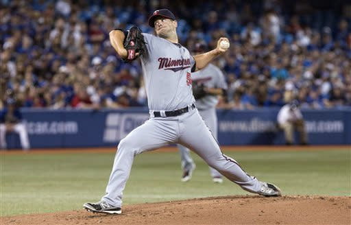 Minnesota Twins starting pitcher Scott Diamond works against the Toronto Blue Jays during first-inning AL baseball game action in Toronto, Sunday, July 7, 2013. (AP Photo/The Canadian Press, Chris Young)