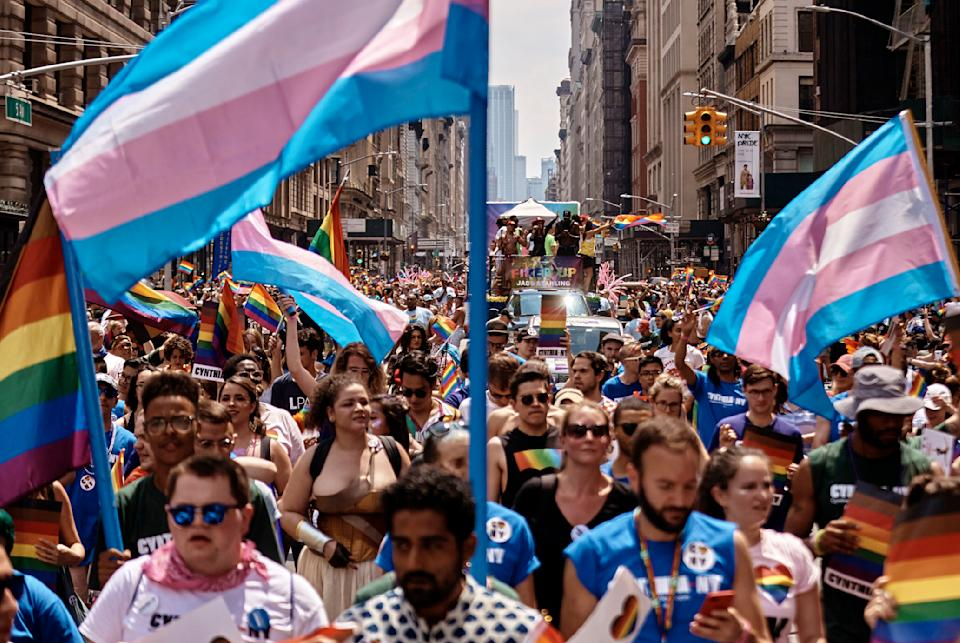 In this June 24, 2018 photo, revelers waving Transgender Pride flags take to the streets during the New York City Pride March. (Photo: AP Photo/Andres Kudacki)