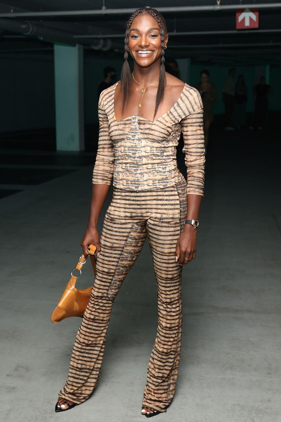 <p><strong>18 September</strong></p><p>Dina Asher-Smith looked chic in stripes for the Knwls show. </p>