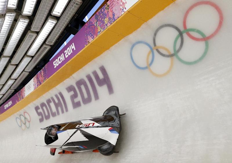 The USA-1 sled from the United States piloted by Steven Holcomb, takes a turn during a training run for the two-man bobsled at the 2014 Winter Olympics, Thursday, Feb. 6, 2014, in Krasnaya Polyana, Russia. (AP Photo/Michael Sohn)