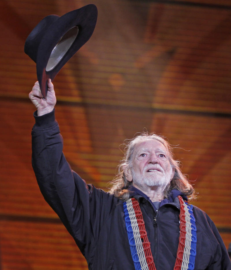 Willie Nelson performs during the 25th anniversary Farm Aid concert Saturday, Oct. 2, 2010,  in Milwaukee. (AP Photo/Jeffrey Phelps)