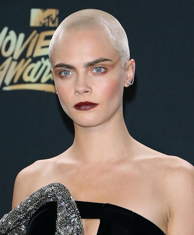 <p>Cara Delevingne's platinum blond, almost-bald head has been stealing the scene from her popular brows lately. (Photo: JB Lacroix/WireImage) </p>