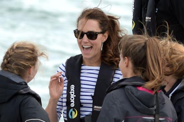The Duchess of Cambridge speaks with crew as the Duke and Duchess of Cambridge race against each other on two Emirates Team New Zealand Americas Cup yachts as they sail around Auckland Harbour during the fifth day of their official tour to New Zealand. PRESS ASSOCIATION Photo. Picture date: Friday April 11, 2014. Photo credit should read: Anthony Devlin/PA Wire