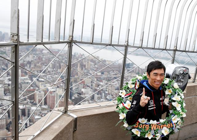Indianapolis 500 winner Takuma Sato poses during a visit to the Empire State Building in New York City, U.S., May 30, 2017. REUTERS/Brendan McDermid