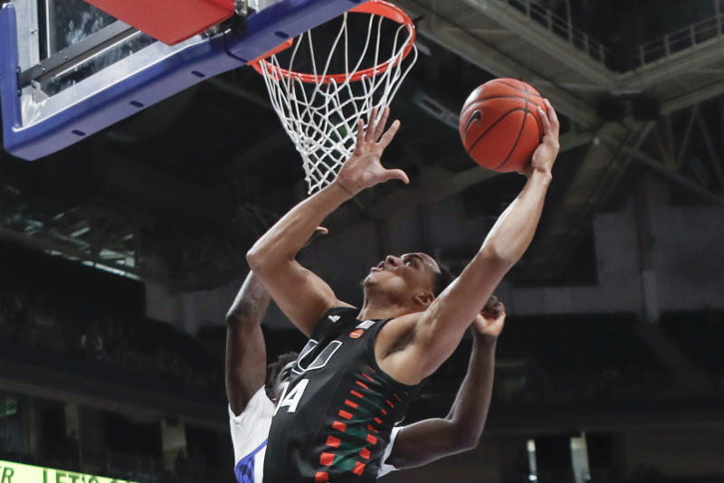 Miami's Rodney Miller Jr. (14) shoots in front of Pittsburgh's Eric Hamilton during the first half of an NCAA college basketball game, Sunday, Feb. 2, 2020, in Pittsburgh. (AP Photo/Keith Srakocic)