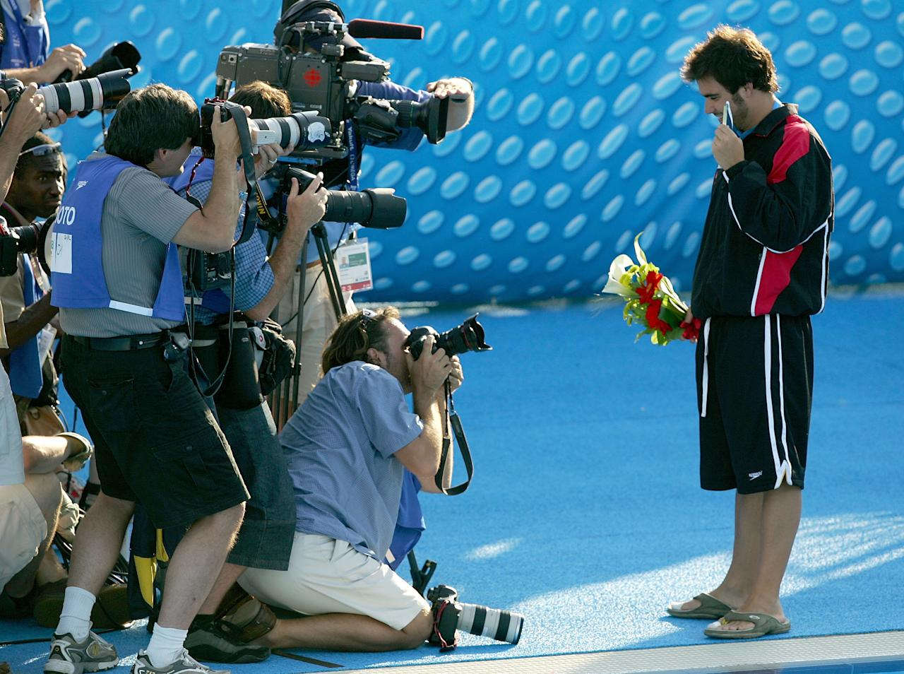 MONTREAL - JULY 19: Alexandre Despatie of Canada poses with his gold medal in the three meter diving final on the podium during the XI FINA World Championships at the Parc Jean-Drapeau on July 19, 2005 in Montreal, Quebec, Canada. (Photo by Al Bello/Getty Images)
