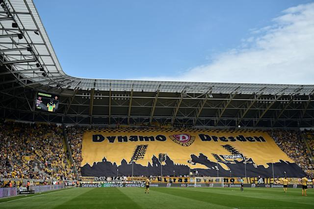 Soccer Football - 2. Bundesliga - Dynamo Dresden v Fortuna Dusseldorf - DDV-Stadion, Dresden, Germany - April 28, 2018 Dynamo Dresden fans display a banner during the match REUTERS/Matthias Rietschel DFL RULES TO LIMIT THE ONLINE USAGE DURING MATCH TIME TO 15 PICTURES PER GAME. IMAGE SEQUENCES TO SIMULATE VIDEO IS NOT ALLOWED AT ANY TIME. FOR FURTHER QUERIES PLEASE CONTACT DFL DIRECTLY AT + 49 69 650050
