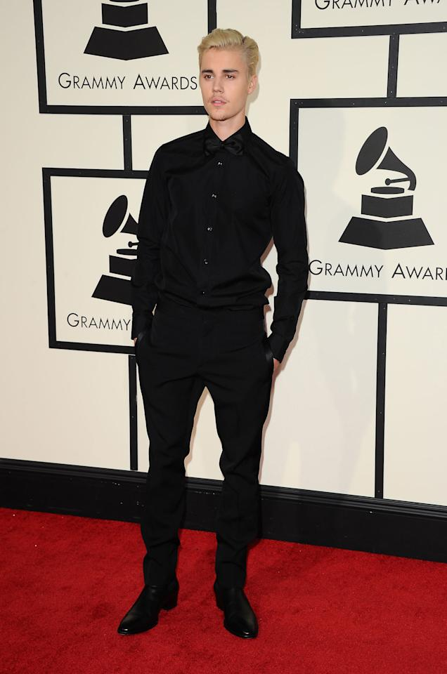 <p>An all-black ensemble helped make Bieber look dapper and dashing at this year's Grammy Awards.<i> [Photo: Rex]</i></p>