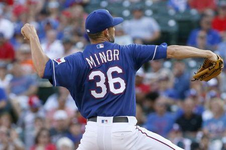Jun 9, 2018; Arlington, TX, USA; Texas Rangers starting pitcher Mike Minor (36) throws a pitch in the first inning against the Houston Astros at Globe Life Park in Arlington. Mandatory Credit: Tim Heitman-USA TODAY Sports