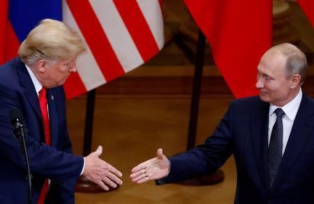 FILE PHOTO: U.S. President Donald Trump and Russian President Vladimir Putin shake hands as they hold a joint news conference after their meeting in Helsinki, Finland, July 16, 2018. REUTERS/Leonhard Foeger/File Photo