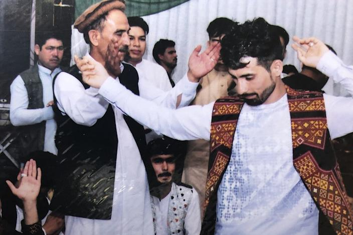 Mirwais dancing on his wedding day, before the bomb hit