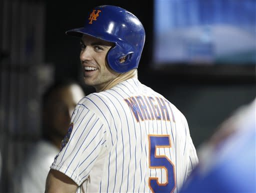 New York Mets David Wright reacts in the dugout after collecting his 1,419th hit to surpass Ed Kranepool for the Mets all-time hits record holder during their baseball game against the Pittsburgh Pirates at Citi Field in New York, Wednesday, Sept. 26, 2012. (AP Photo/Kathy Willens)