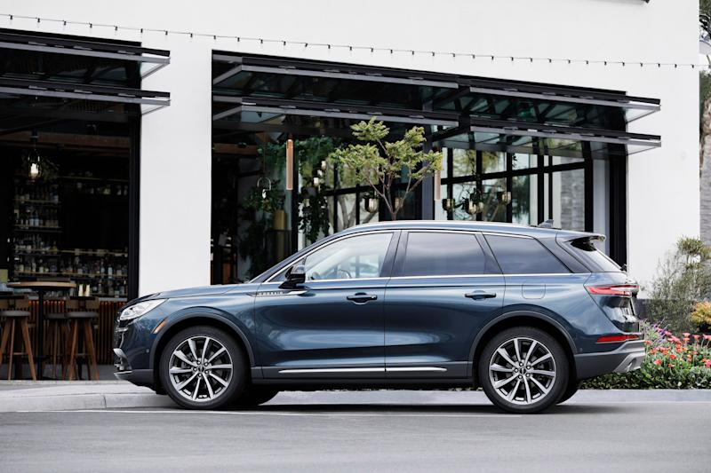 The 2020 Lincoln Corsair compact luxury SUV's side features a sharply angled tailgate and deeply sculpted doors.