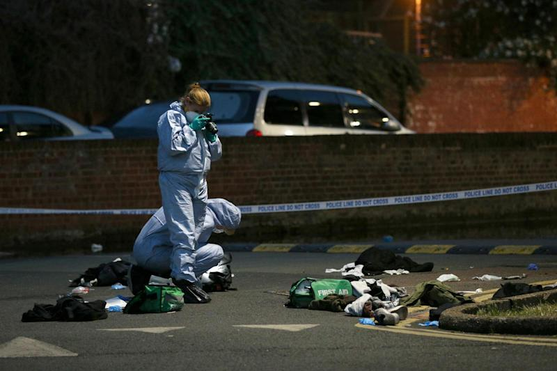 Quadruple stabbing: Forensics officers inspect the scene of a knife attack in Camberwell last week: PA