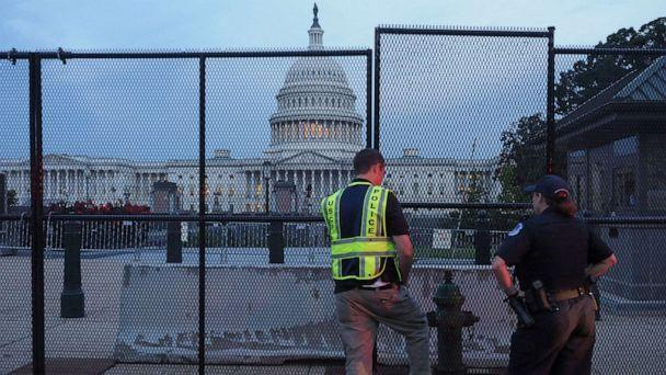 PHOTO: U.S. Capitol Police officers look over the integrity of the fence put up to secure the US Capitol  and its grounds in advance of 9/18 Justice for J6 rally, Sept. 16, 2021, in Washington, D.C. (Sue Dorfman/ZUMA Wire via Newscom)
