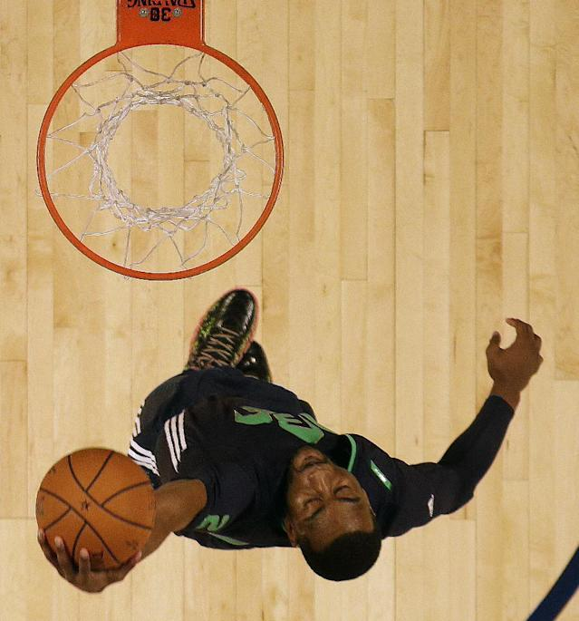 East Team John Wall, of the Washington Wizards (2) heads to the hoop during the NBA All Star basketball game, Sunday, Feb. 16, 2014, in New Orleans. (AP Photo/Gerald Herbert)