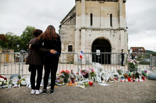 Peace trumps fear for voters in French town where priest slain