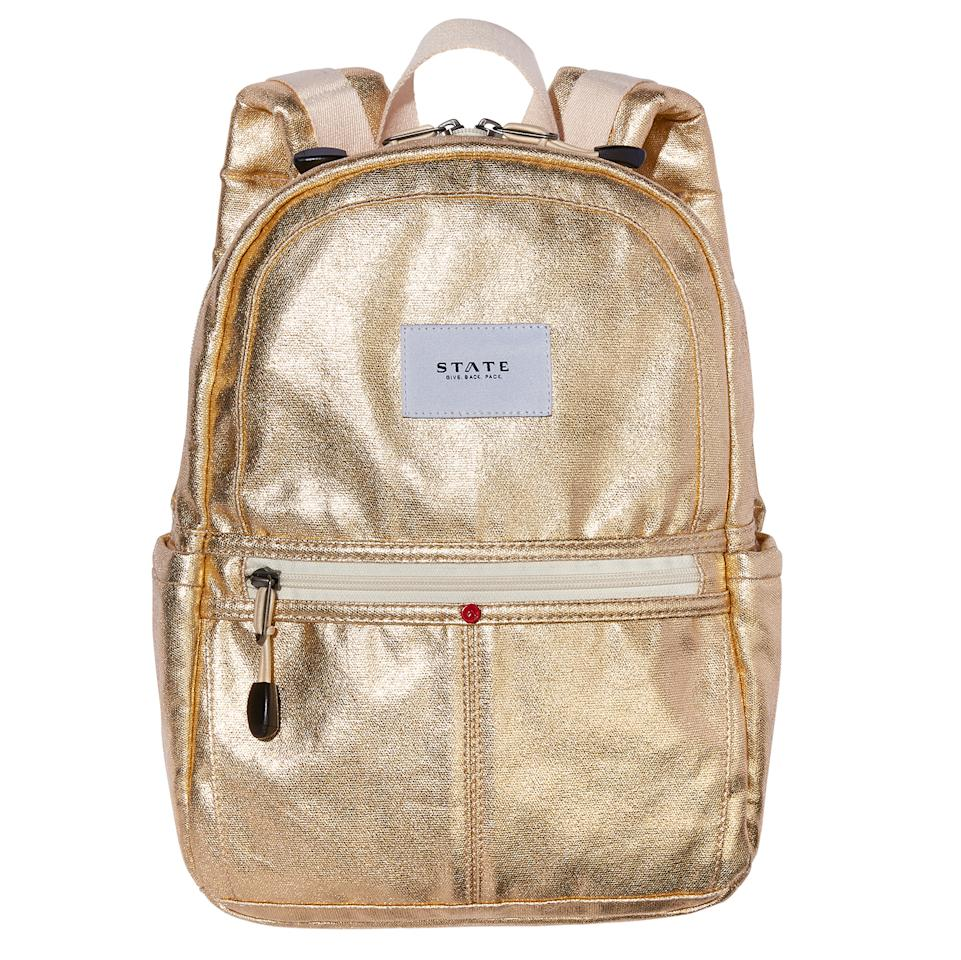 "<p>The company's <a rel=""nofollow"" href=""https://www.statebags.com/pages/give-back-pack"">Give Back Pack</a> program runs a buy-one, give-one model. For every Kane bag sold, STATE will give a backpack (pre-loaded with important supplies) to a child in need.</p><p>Buy it <a rel=""nofollow"" href=""https://click.linksynergy.com/fs-bin/click?id=93xLBvPhAeE&subid=0&offerid=390098.1&type=10&tmpid=8158&RD_PARM1=https%253A%252F%252Fshop.nordstrom.com%252Fs%252Fstate-bags-downtown-mini-kane-canvas-backpack%252F4513945&u1=IS%2CHOL%2CGAL%2CHolidayGiftsThatGiveBack%2Clkane1271%2C201711%2CT"">here</a> for $55.</p>"