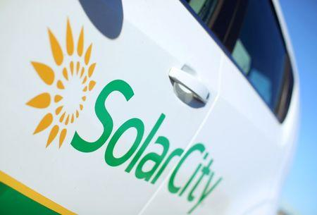 A Solar City logo is seen on the side of a company vehicle in San Diego, California