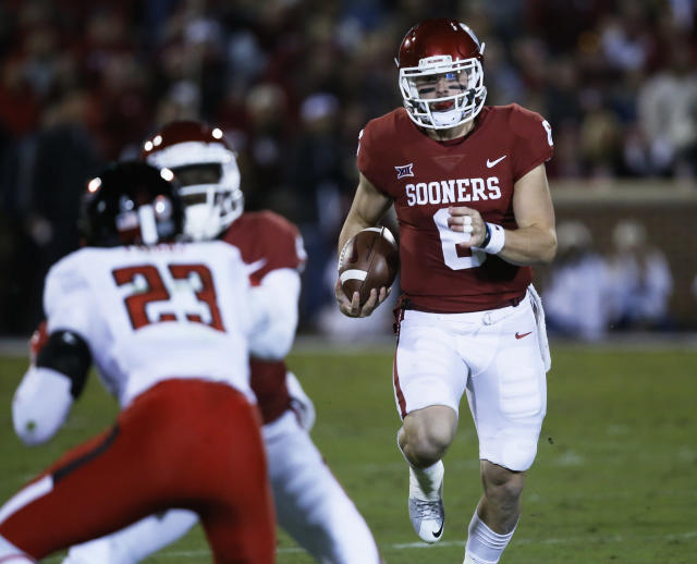 "Oklahoma quarterback <a class=""link rapid-noclick-resp"" href=""/ncaaf/players/229650/"" data-ylk=""slk:Baker Mayfield"">Baker Mayfield</a> (6) carries in the first quarter of an NCAA college football game against Texas Tech in Norman, Okla., Saturday, Oct. 28, 2017. (AP Photo/Sue Ogrocki)"