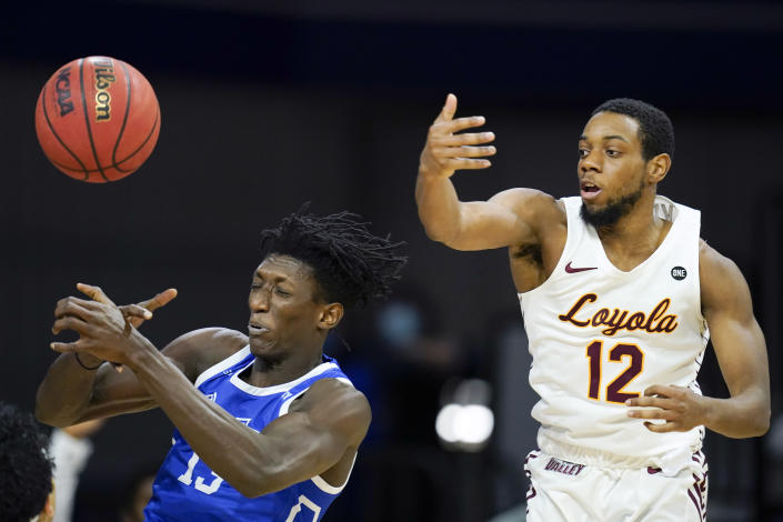Drake forward Issa Samake, left, fights for a rebound with Loyola of Chicago guard Marquise Kennedy (12) during the second half of an NCAA college basketball game, Sunday, Feb. 14, 2021, in Des Moines, Iowa. Drake won 51-50 in overtime. (AP Photo/Charlie Neibergall)