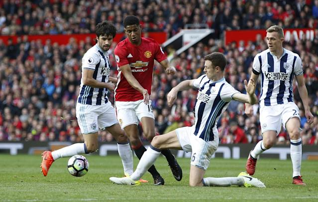 <p>Manchester United's Marcus Rashford in action with West Bromwich Albion's Claudio Yacob, Jonny Evans and Darren Fletcher </p>