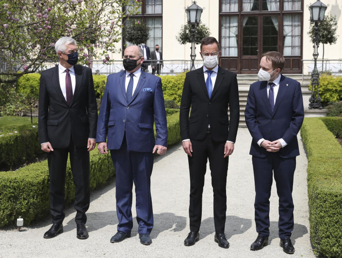 Slovak Foreign Minister Ivan Korcok, left,Polish Foreign Minister Zbigniew Rau, Hungarian Foreign Minister Peter Szijjarto and Czech Republic Foreign Minister Tomas Petricek,right, pose after meeting the foreign ministers of the Visegrad Group ,V4, in Lodz, Poland, Friday, May 14, 2021.(AP Photo/Czarek Sokolowski)