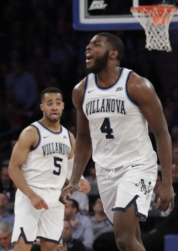 Villanova's Eric Paschall (4) celebrates after scoring as teammate Phil Booth (5) watches during the second half of an NCAA college basketball game against Providence in the Big East Conference tournament Thursday, March 14, 2019, in New York. Villanova won 73-62. (AP Photo/Frank Franklin II)
