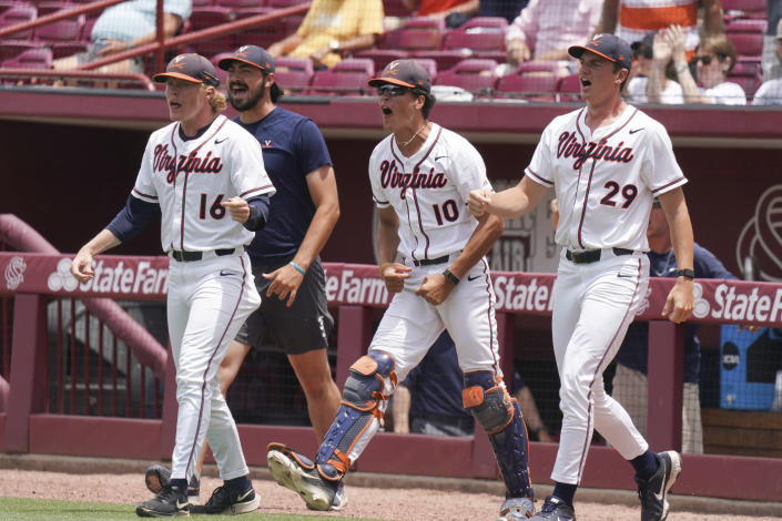 Virginia's Andrew Abbott (16), Tate Ballestero (10), and Zach Messinger (29) react to an inning ending out in the top of the seventh inning during an NCAA college baseball tournament super regional game against Dallas Baptist Sunday, June 13, 2021, in Columbia, S.C. Virginia won 4-0. (AP Photo/Sean Rayford)