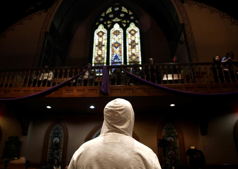 A man wears a hoodie before the start of a service at Middle Collegiate Church in New York, Sunday, March 25, 2012. Church-goers were invited to wear hoodies to services to show their support for justice in the case of Trayvon Martin, an unarmed black teenager who was wearing a hoodie on the night he was killed by a neighborhood watch captain in Florida. (AP Photo/Seth Wenig)