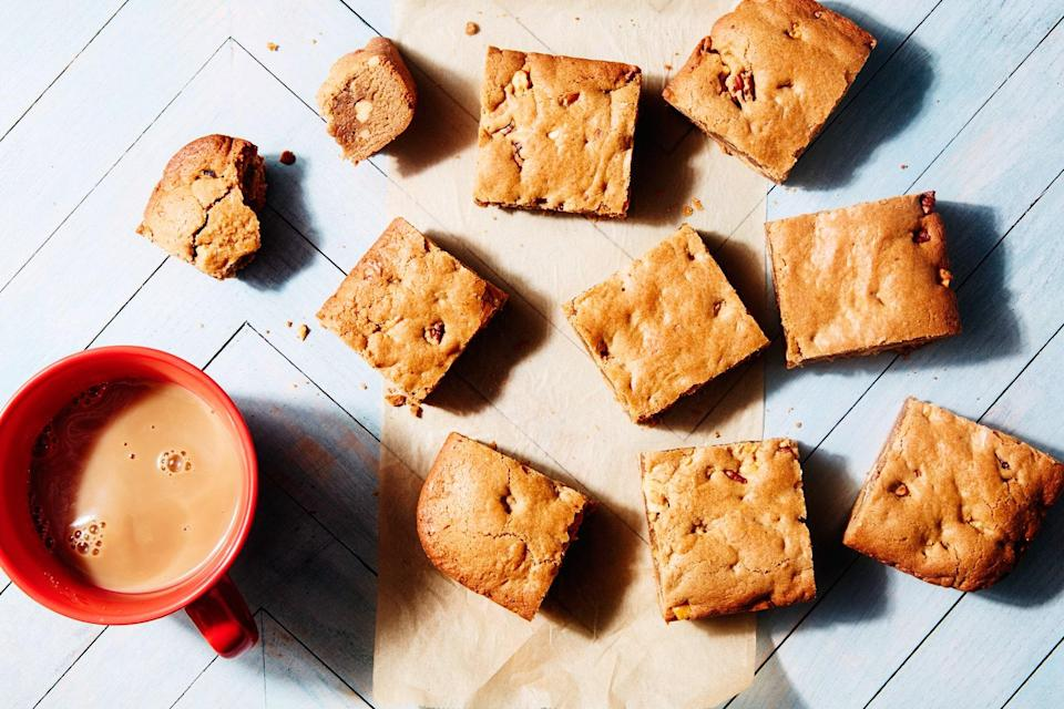 """This chewy, nut-filled blondie recipe comes from <em>EveryDayCook</em> by Alton Brown. <a href=""""https://www.epicurious.com/recipes/food/views/blondies?mbid=synd_yahoo_rss"""" rel=""""nofollow noopener"""" target=""""_blank"""" data-ylk=""""slk:See recipe."""" class=""""link rapid-noclick-resp"""">See recipe.</a>"""