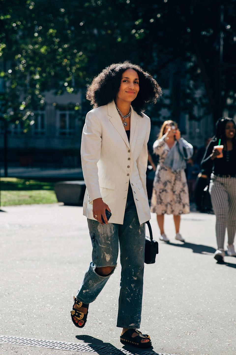 <p>Trade out suit pants for distressed denim and predictable footwear for summer-friendly sandals.</p>