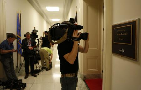 Journalists gather outside the office of Representative Aaron Schock (R-IL) on Capitol Hill in Washington March 17, 2015. Schock is resigning from Congress, U.S. House Speaker John Boehner said on Tuesday. Schock's resignation follows news reports that raised questions about his use of taxpayer dollars. He did not notify any House Republican leaders before making his decision, a House Republican aide said.REUTERS/Yuri Gripas (UNITED STATES - Tags: POLITICS)