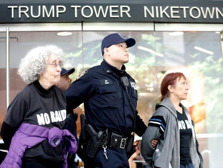 Protesters are led way from Trump Tower by police: REUTERS/Brendan McDermid