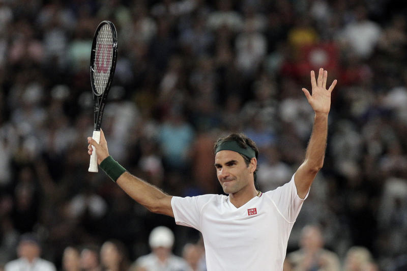 Roger Federer thanks the crowd after winning 3 sets to 2 against Rafael Nadal in their exhibition tennis match held at the Cape Town Stadium in Cape Town, South Africa, Friday Feb. 7, 2020. (AP Photo/Halden Krog)