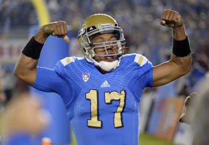 Nov 22, 2014; Pasadena, CA, USA; UCLA Bruins quarterback Brett Hundley (17) celebrates after scoring a touchdown against the Southern California Trojans during the second half at the Rose Bowl. (Richard Mackson-USA TODAY Sports)