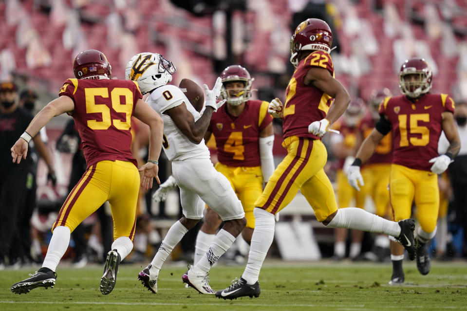 Arizona State's Jack Jones (0) fumbles the ball on a punt return against Southern California during the first half of an NCAA college football game Saturday, Nov. 7, 2020, in Los Angeles. (AP Photo/Ashley Landis)