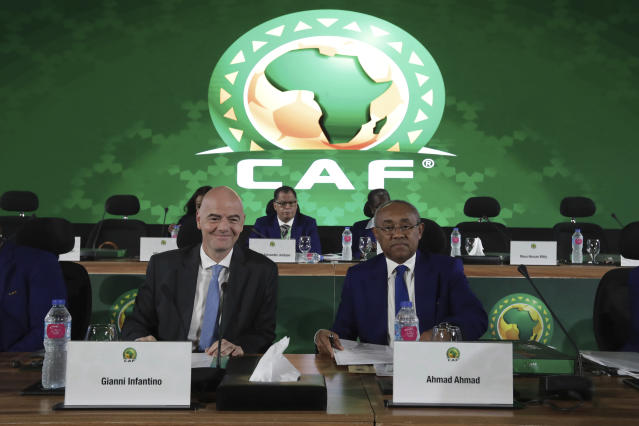 Confederation of African Football president Ahmad Ahmad of Madagascar, right, and FIFA president Gianni Infantino pose for a photo during the Confederation of African Football general assembly in Cairo, Egypt, Thursday, July 18, 2019. The African soccer body is holding its first major meeting since announcing that FIFA will send a senior official to lead a clean-up of the scandal-plagued organization in an unprecedented move for soccer. The Confederation of African Football, whose president is facing numerous allegations of corruption amid the crisis, is holding its general assembly on Thursday in Cairo on the eve of the African Cup final. (AP Photo/Hassan Ammar)