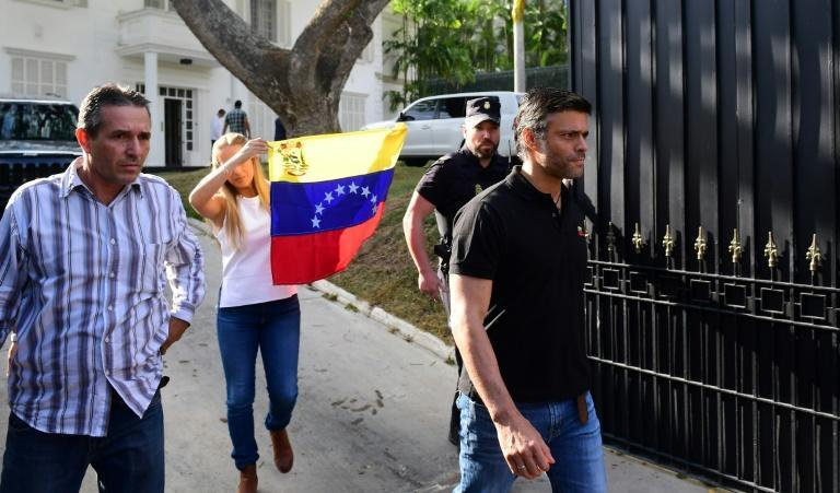 Venezuelan high-profile opposition politician Leopoldo Lopez, pictured in 2019, followed by his wife Lilian Tintori carrying a Venezuelan flag walks out the Spanish embassy in Caracas