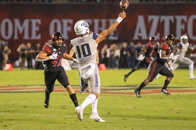Utah State QB Jordan Love is off to a slow start but still could find his way into Round 1. (Getty Images)