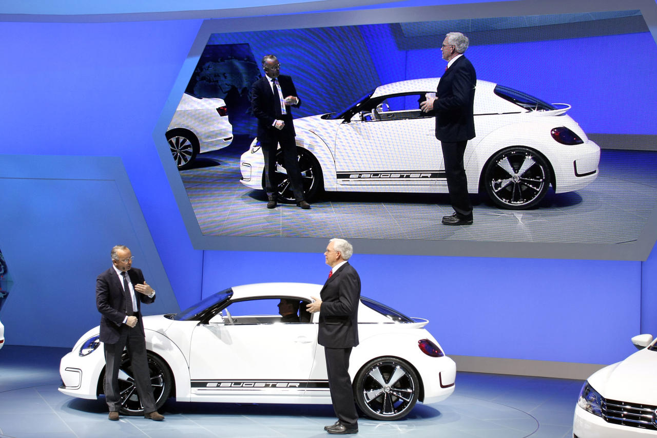 DETROIT, MI - JANUARY 9: Walter de Silva (L), Head of Group Design Volkswagen Group, and Dr. Ulrich Hackenberg, Member of the Board Volkswagen Brand, reveal the new E Bugster during a media, and preview at the 2012 North American International Auto Show January 9, 2012 in Detroit, Michigan. The show is open to the general public January 14-22. (Photo by Bill Pugliano/Getty Images)