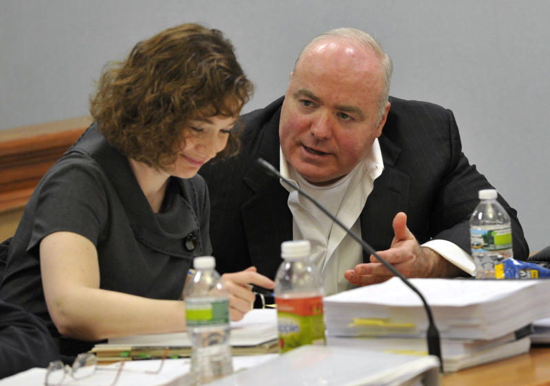 Michael Skakel, right, talks with Jessica Santos, one of his defense attorneys, during Skakel's appeal trial at Rockville Superior Court in Vernon, Conn., on Thursday, April 25, 2013.   Skakel launched a barrage of criticism Thursday against the attorney who represented him at his murder trial, saying he failed to track down key witnesses while having fun and basking in the limelight.  Skakel is serving 20 years to life in prison for the 1975 golf club bludgeoning of Martha Moxley in Greenwich when they were both 15 years old. Skakel argues trial attorney Michael Sherman got caught up in the limelight of the high-profile case and failed to prepare. (AP Photo/The Stamford Advocate, Jason Rearick, Pool)